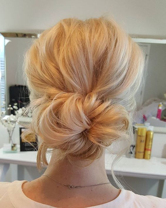 a soft and messy boho bun with a bump and bangs is a chic and sexy idea to rock