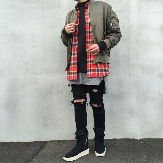 black ripped skinnies, tall black sneakers, a grey tee, a black hoodie, a red plaid shirt, an olive green bomber