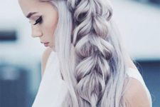 07 long wavy hair down with a large side fishtail braid is a gorgeous holiday statement