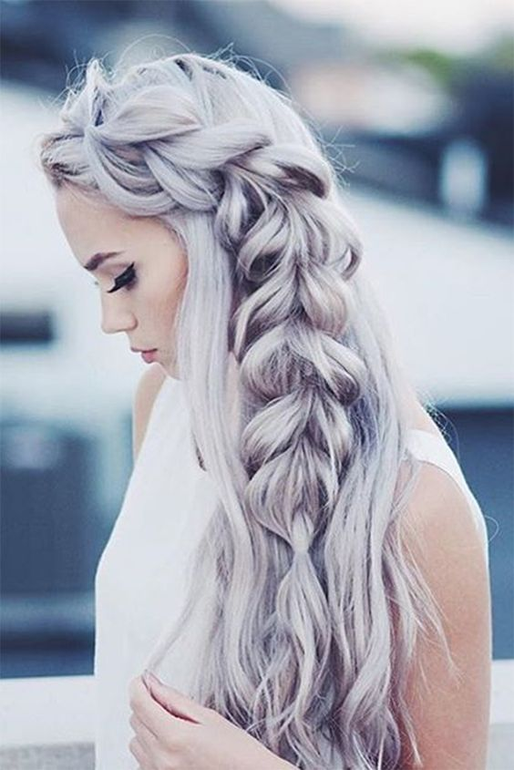 long wavy hair down with a large side fishtail braid is a gorgeous holiday statement