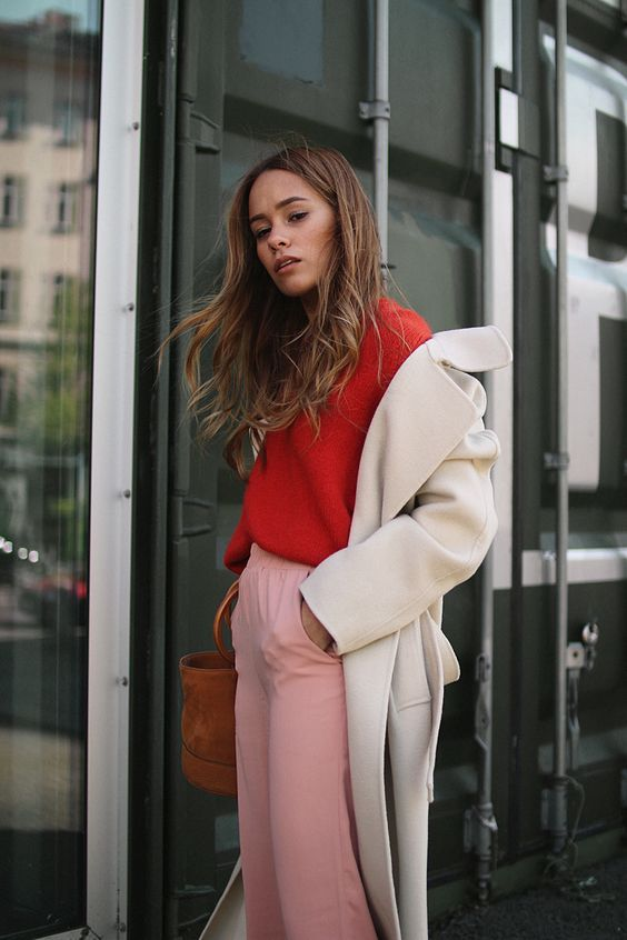 pink pants, a coral sweater, a creamy coat will keep you warm and trendy