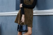 08 a black turtleneck, a brown suede dress, a black bag and black booties to rock