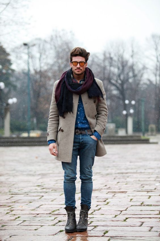 blue jeans, a blue printed shirt, a neutral coat, black boots and a colorful scarf