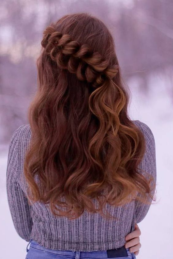 long wavy hair with a large fishtail braid going diagonally as an accessory