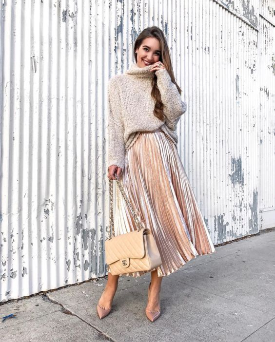 a blush velvet midi skirt, dusty pink shoes, a neutral oversized sweater, a neutral bag for a tender look