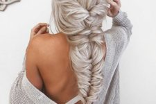09 a jaw-dropping twisted and fishtail braid with bangs is a wow statement for any party