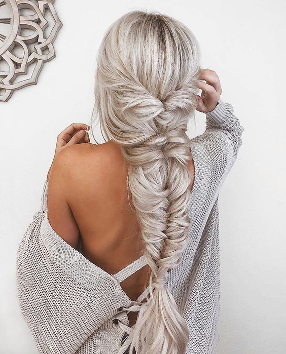 a jaw-dropping twisted and fishtail braid with bangs is a wow statement for any party