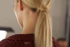 09 a low ponytail with straightened hair and a messy bump is a chic and modern option