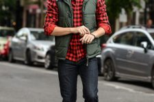 09 a plaid shirt, black jeans, amber shoes, an olive green vest and sunglasses for a comfy holiday look