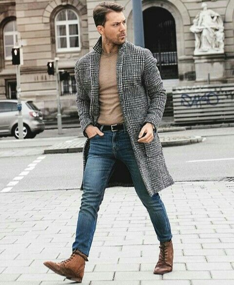 a simple casual look with blue jeans, a tan long sleeve, brown boots and a grey plaid overcoat