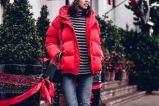 09 a striped turtleneck, ripped blue skinnies, a red puffer jacket, black boots, a grey beanie