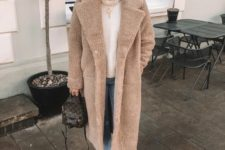 09 a white turtleneck sweater, blue cropped jeans, a neutral teddy coat and a printed bag