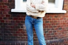 09 an oversized neutral sweater, blue jeans, a brand belt and bright orange shoes for a flirty touch