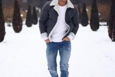 09 blue ripped jeans, camel boots, a white sweater and a grey and white shearling jacket