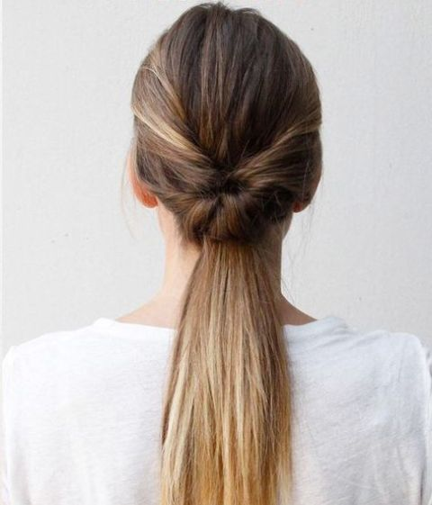 a double twist low ponytail is a more fresh and modern take on a traditional hairstyle