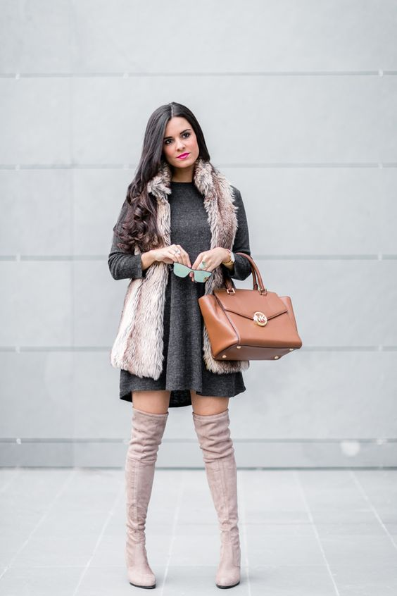 a graphite grey mini dress, a fur waistcoat, tall neutral boots and a camel bag for a girlish look
