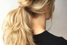 10 a low ponytail made of two twisted side braids, with waves and a bump plus bangs