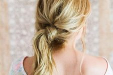 10 a messy and textural low side ponytail with some bangs and a bump is a fast DIY hairdo