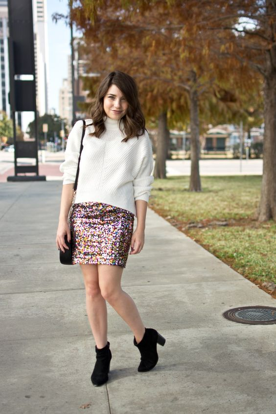 a white turtleneck sweater, a colorful sequin mini, black booties and a black bag to sparkle but not too much