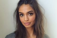 10 textural hair down and a top knot is a simple and casual hairstyle for holidays