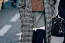 11 a comfy layered look with a grey shirt, black jeans, black shoes, a grey plaid coat and an oversized brown scarf