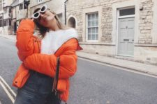 11 a fun and fresh look with a fuzzy white sweater, a denim mini and an orange puffer coat