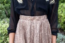 11 a gold sequin mini with a high waist and a black sheet blouse with long sleeves and a V-neckline