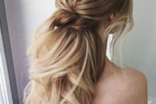 11 a low twisted ponytail with waves, a bump and bangs is a gorgeous idea to show off your hair