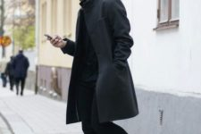 11 a total black look with jeans, a top, an overcoat is refreshed with white sneakers