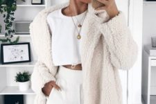 11 a white crop top, white high waisted pants, a creamy teddy coat for a stylish statement