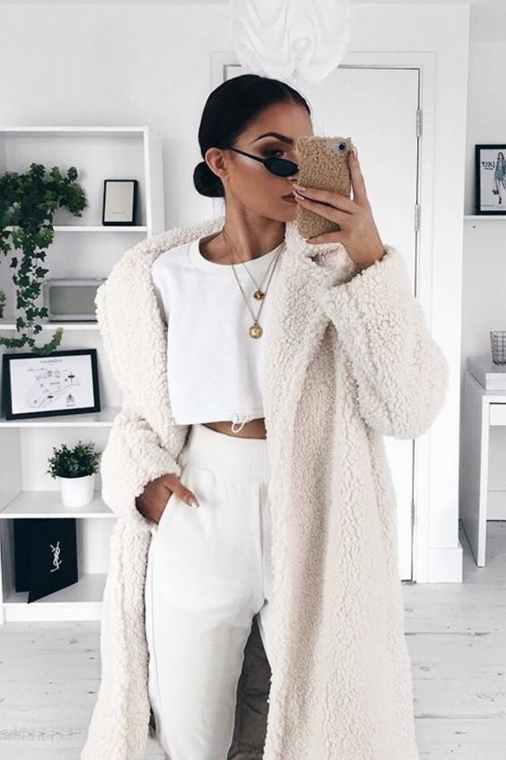 a white crop top, white high waisted pants, a creamy teddy coat for a stylish statement