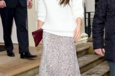 11 a white oversized turtleneck sweater, a pleated printed midi skirt, burgundy velvet boots