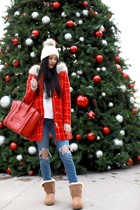 a white sweater, ripped skinnies, neutral ugg boots, a red plaid coat and a white beanie