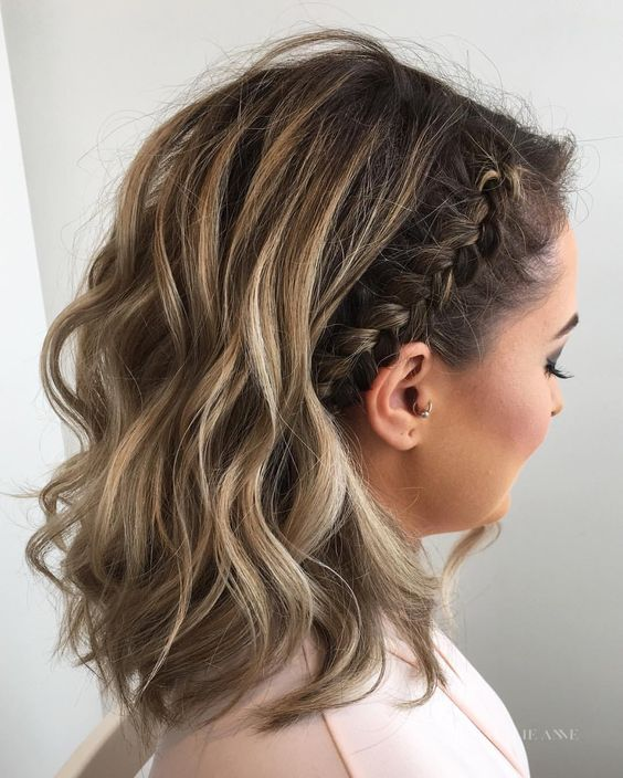 wavy medium length hair with a side braid is a trendy idea with a slight boho feel