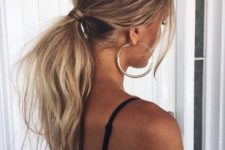 12 a low messy wavy ponytail with a bump and some bangs is a chic casual idea suitable even for dates