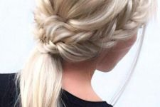 12 a low ponytail with two side fishtail braids and a bump is a chic and casual option