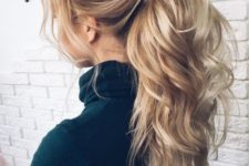 12 a luxurious messy and wavy ponytail with bangs and a large bump is a bold idea for long hair