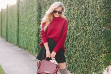 12 a red oversized sweater, a black A-line mini, grey tall boots and a red bag for a playful touch
