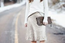 12 a white turtleneck sweater, a silver sequin A-line skirt, nude shoes and a leopard printed clutch