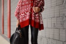 12 black boots, black leather leggings, a black sweater, beanie and bag plus a Scandi print red cape