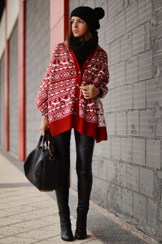 black boots, black leather leggings, a black sweater, beanie and bag plus a Scandi print red cape