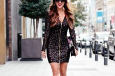 12 black sequin geometric mini dress with a zipper on the front, black heels and a clutch
