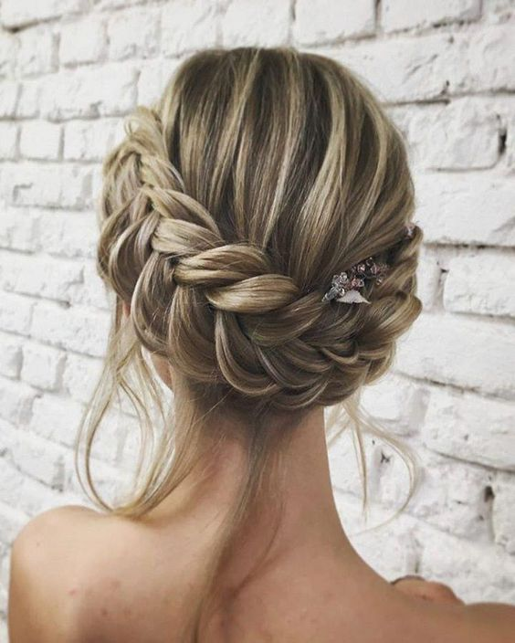 a braided Christmas halo updo with bangs and a hairpiece is a boho chic option