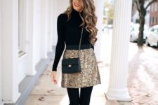 13 a gold super mini is balanced withh a black turtleneck, tights and shoes for a comfier look