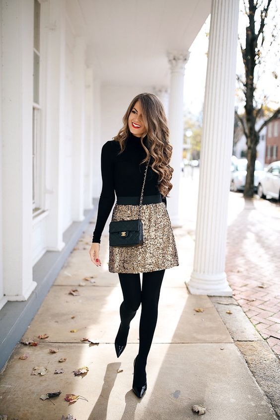 a gold super mini is balanced withh a black turtleneck, tights and shoes for a comfier look