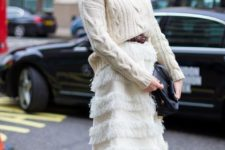 13 a whimsy outfit of a creamy cable knit sweater, a feathered knee skirt, bright yellow lace up shoes