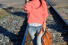 13 a white tee, c roal pink sweater, blue jeans, white sneakers and a cognac-colored bag