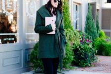 13 black jeans, an emerald coat, nude heels, a blush beanie and a clutch for a festive look