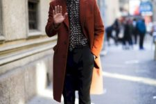 13 black pants, a printed shirt, black shoes and a chocolate brown overcoat to keep you warm