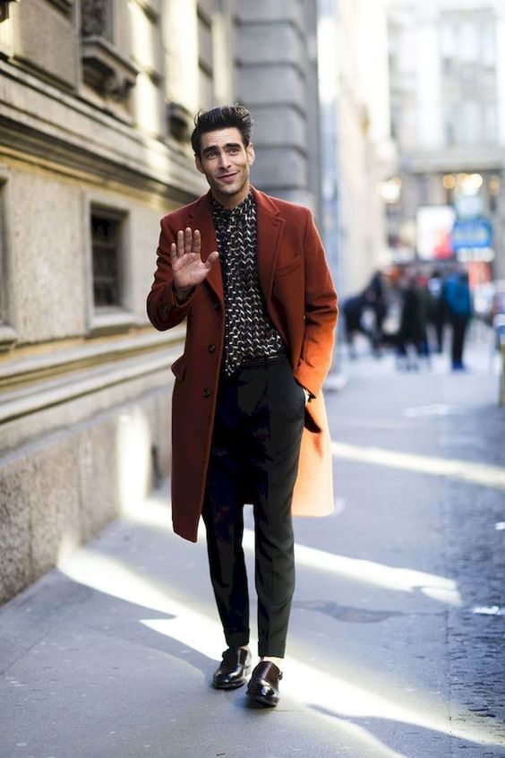 black pants, a printed shirt, black shoes and a chocolate brown overcoat to keep you warm